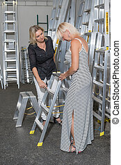 Shopping for ladder at hardware store.
