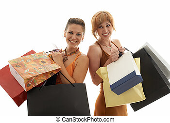shopping girls - two happy girls with shopping bags
