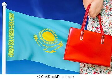 Shopping in Kazakhstan. Woman with red leather bag.