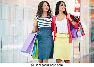 Shopping in the mall - Gorgeous girlfriends with paperbags...