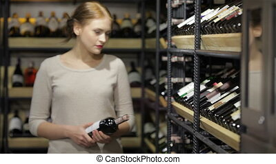 Shopping in the supermarket, wine shelves