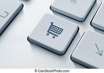 Shopping cart icon on keyboard key. Toned Image.