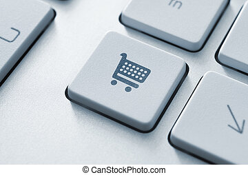 Shopping Key - Shopping cart icon on keyboard key. Toned...