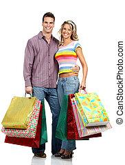 Shopping love couple - Shopping couple smiling. Isolated...