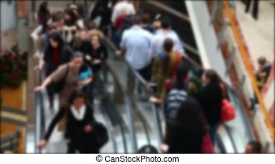 Shopping mall escalator (no focus) - Escalator with people...