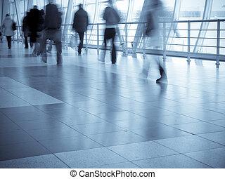 Shopping mall  - Shoppers walking, motion blur