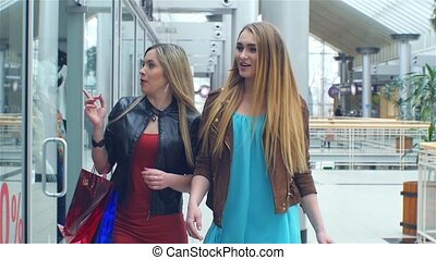 shopping: meeting friends. two girls .slow motion