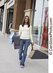 Shopping - Model Release 314 Woman enjoying a day of...