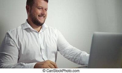 Shopping online concept. man holding credit card and using laptop.