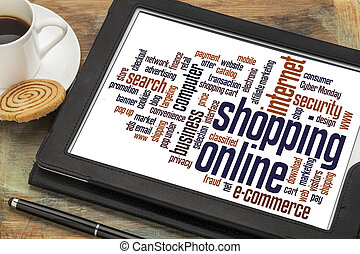 shopping online word cloud on a digital tablet with a cup of coffee