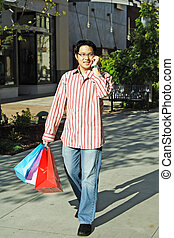 Shopping - A young man talking on the phone while shopping...
