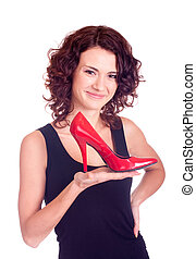 girl holding red shoe
