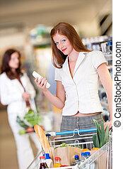 shopping, série, -, cabelo vermelho, mulher segura, shampoo