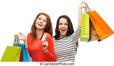 teenage girls with shopping bags and credit card