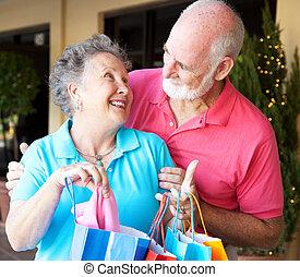 Shopping Seniors In Love - Happily married senior couple on...