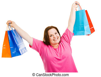Shopping Success - Happy plus-sized woman holding up her...
