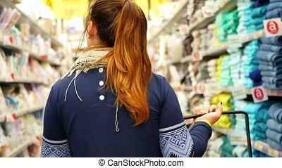 Shopping supermarket hair - Woman shopping at the...