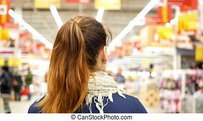 Shopping supermarket hair - Woman shopping at the...