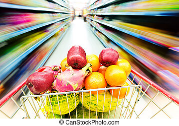 Shopping - Supermarket interior, filled with the fruit of ...