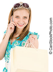 Shopping teenager woman with mobile phone
