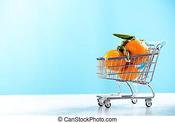 Shopping trolley cart full of oranges