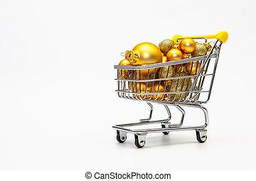 Shopping trolley full of gold Christmas balls