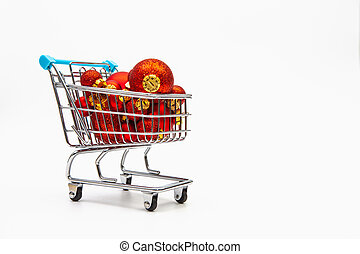 Shopping trolley full of red Christmas balls