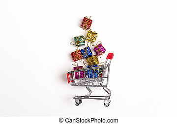 Shopping trolley with gift boxes on white background.