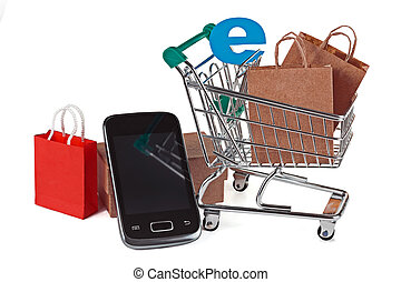 Shopping trolley with shopping bags and smartphone