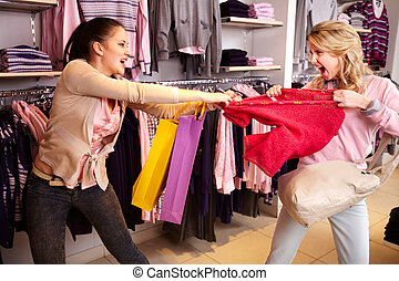 Shopping violence - Image of two greedy girls fighting for ...