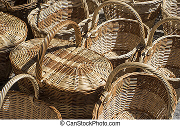 Shopping, wicker baskets handmade in a traditional medieval shop, crafts in Spain