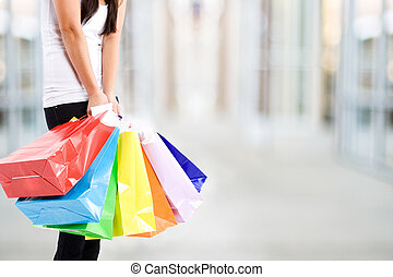 Shopping woman - A shot of a woman carrying shopping bags at...
