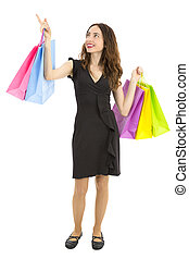 Shopping woman pointing copy space