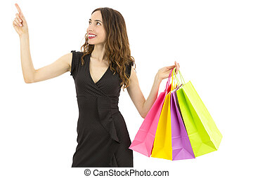 Shopping woman pointing to copy space