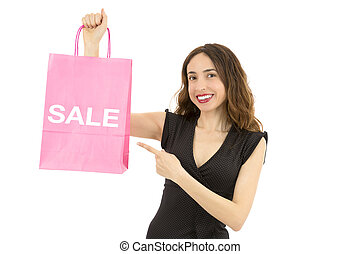 Shopping woman pointing to sale sign on a paper shopping bag