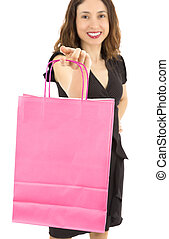 Shopping woman showing a pink blank shopping bag