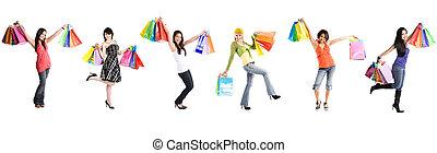 Shopping women - A group of multi ehtnic women carrying...