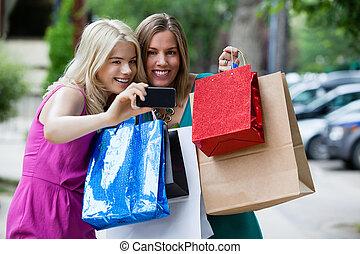 Shopping Women taking Photograph