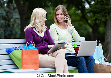 Shopping Women Using Digital Tablet and Cellphone