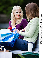 Shopping Women with Takeaway Coffee