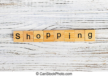 Shopping Word Written In Wooden Cube concept