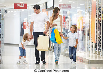 Shopping - Young family with two children in the store