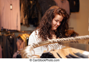 Shopping - Young woman looking at clothes