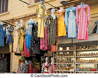 Shops in Cairo. - Shops with colored dresses....