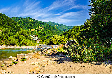 shore of a river in mountain rural area - shore of a...