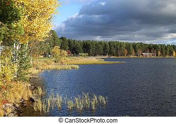 Shore of lake Talvatissjon in Jokkmokk, Sweden