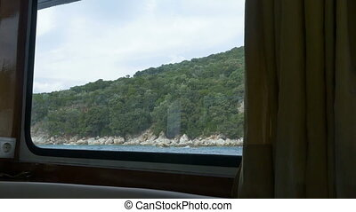 Shore View from Ship Cabin - Seashore view by cabin window...