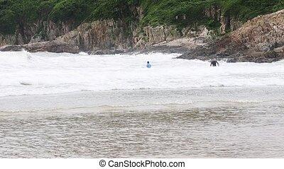 Shore - water against rocks