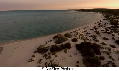 Shoreline and a beach - An aerial shot of a shoreline and...