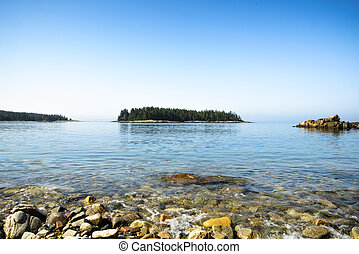 Island scene and shoreline at Schoodic Peninsual in Acadia National Park, Maine.